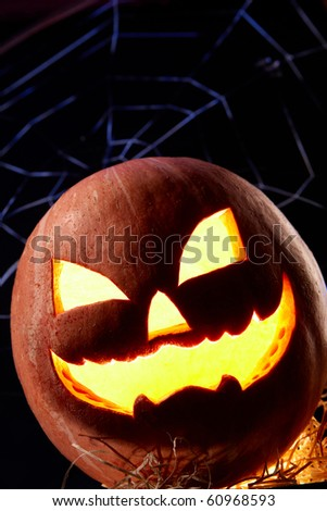 Image of Halloween jack o'lantern with cobweb on background - stock photo
