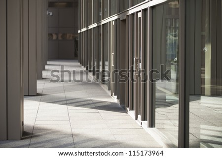 Image of hallway with glass wall - stock photo