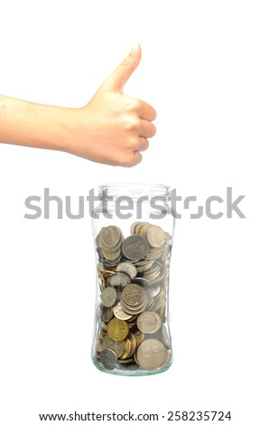 Image of hand showing good sign with coin in bottle, saving concept - stock photo