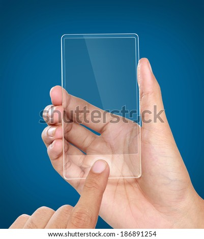 image of hands holding futuristic transparent mobile phone - stock photo