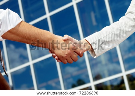 Image of handshaking of business partners - stock photo