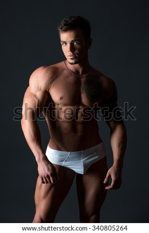 Image of handsome blue-eyed guy with fit body - stock photo