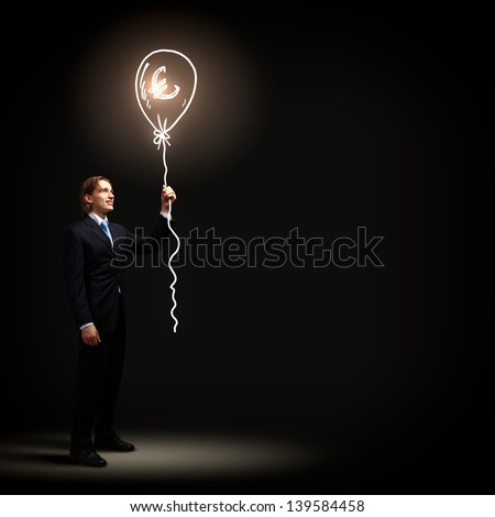 Image of handsome businessman against dark background - stock photo