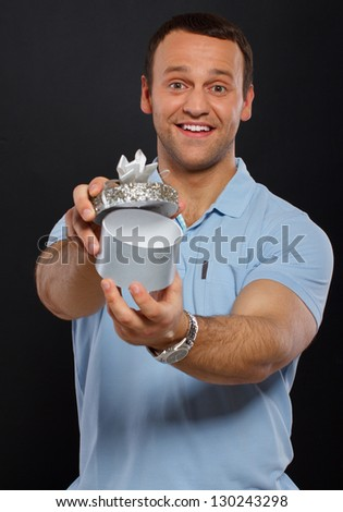 Image of handsome guy who offers a little gift