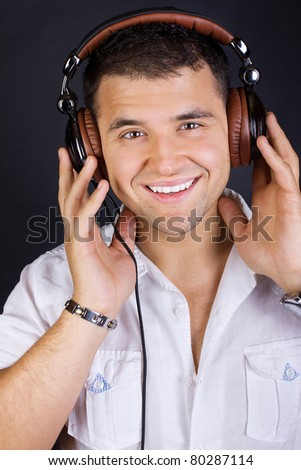 Image of handsome male DJ - stock photo