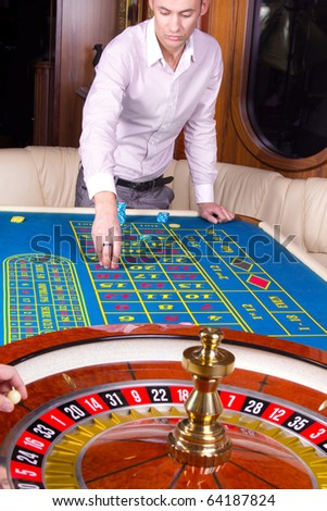 Image of handsome player near roulette