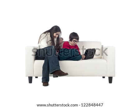 Image of happy brother and sister sitting in a couch against white background