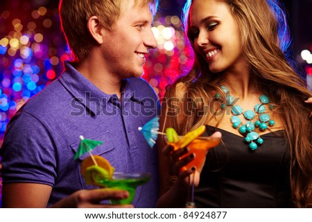 Image of happy couple having fun in the night club - stock photo