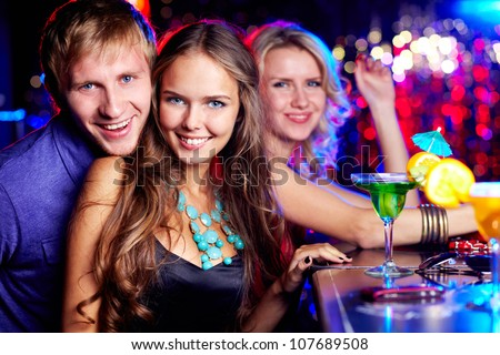 Image of happy friends looking at camera at party - stock photo