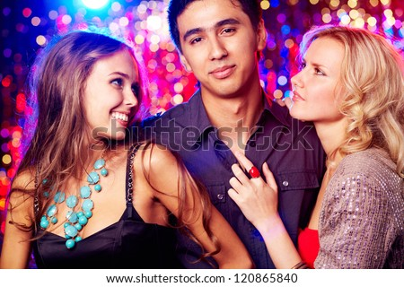 Image of happy girls and guy clubbing together at party - stock photo