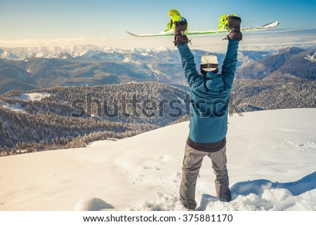 Image of happy male snowboarder on the background of high mountain Alps, Swiss. Successful. Healthy lifestyle. Copy space - stock photo