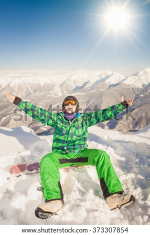 Image of happy male snowboarder or skier on the background of high mountain Alps, Swiss. Successful. Healthy lifestyle. Copy space with sun - stock photo