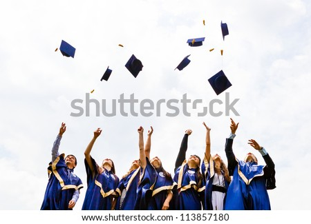 Image of happy young graduates throwing hats in the air - stock photo