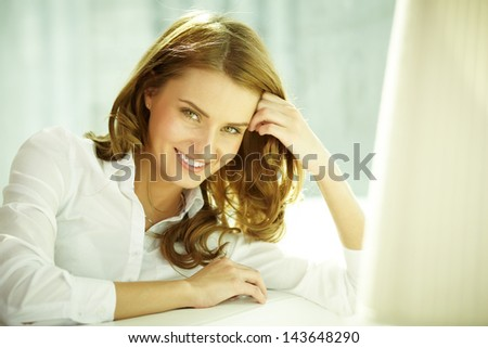 Image of happy young woman looking at camera - stock photo