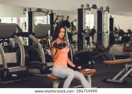 Image of healthy young female athlete doing fitness workout in fitness center. copy space - stock photo