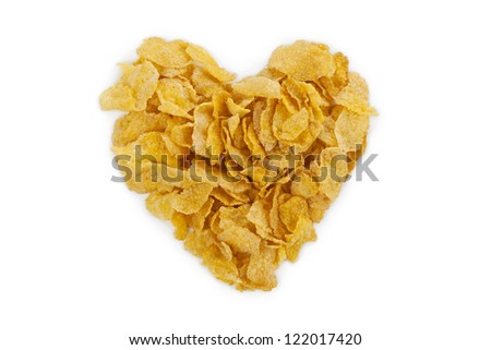 Image of heart shape made of corn flakes against white background - stock photo