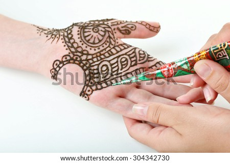 Image of henna applied on female hand isolated on white - stock photo