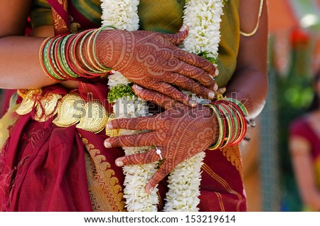 Image of Henna Tattoo's on an Indian bride's hands - stock photo