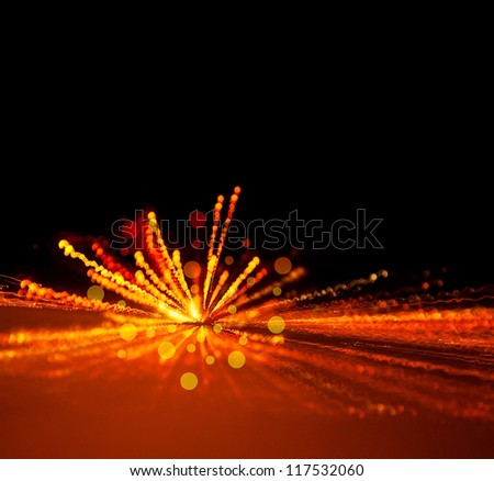 Image of holiday lights background, festive firework, abstract blur backdrop, birthday party, bright yellow light flash, xmas eve, dark night with glowing sparks, merry christmas greeting card - stock photo