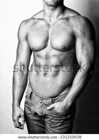 Image of hot and shirtless male body in jeans - stock photo