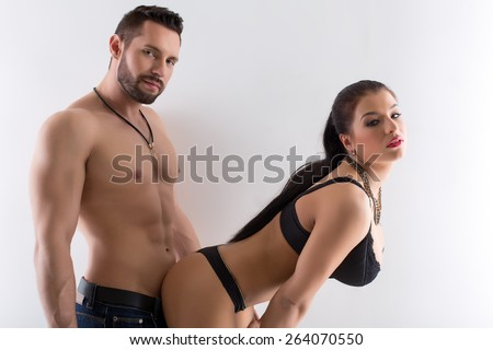Image of hot couple posing in provocative pose - stock photo