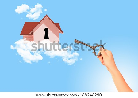 Image of house with key hole. Mortgage concept - stock photo