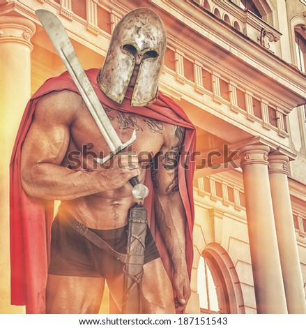 Image of huge half naked warrior near the old Rome building