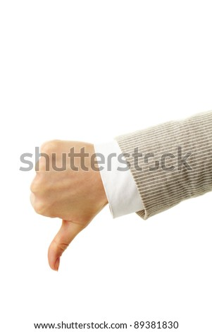 Image of human hand showing thumb down in isolation - stock photo