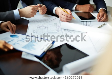 Image of human hands during discussion at meeting