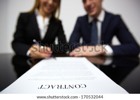 Image of human hands during signing contract - stock photo