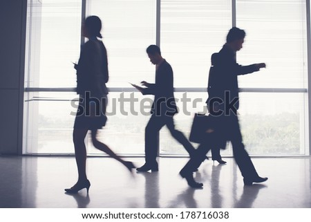 Image of hurry business silhouettes during the rush hour indoors  - stock photo