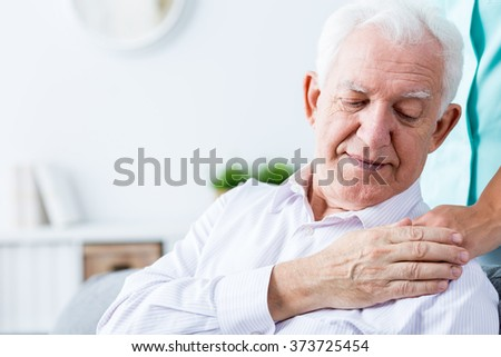 Image of ill positive senior man with support - stock photo