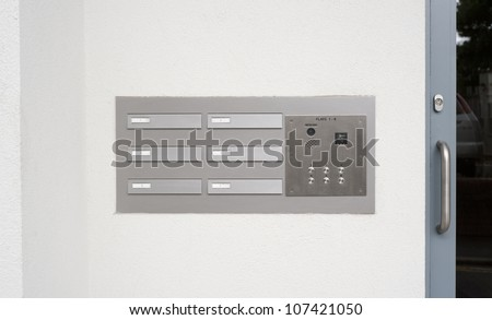 image of intercom doorbell and access code panel - stock photo