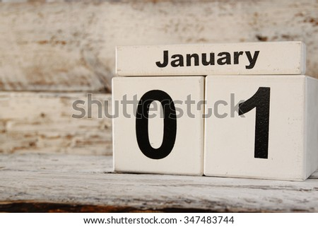 image of January First wooden vintage calendar on white background.  - stock photo