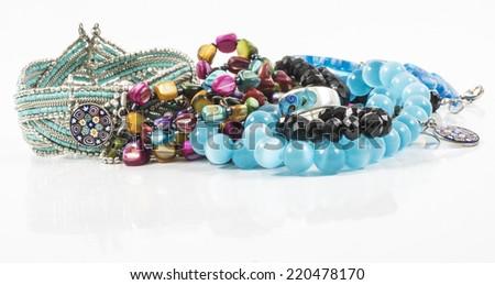 Image of jewalery bracelet, necklaces, earrings blue isolated - stock photo