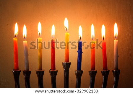 Image of jewish holiday Hanukkah background with menorah (traditional candelabra) Burning candles  - stock photo