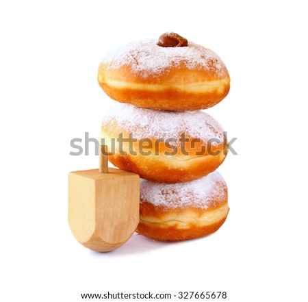 image of jewish holiday Hanukkah with donuts and wooden dreidel (spinning top). isolated on white  - stock photo
