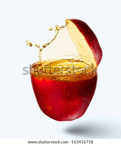 Image of juicy apple in splashes. Refreshing and healthy - stock photo