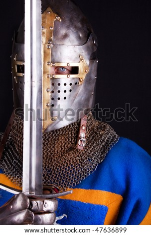 Image of knight holding his sword - stock photo