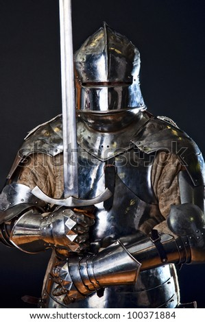 Image of knight in metal armor - stock photo