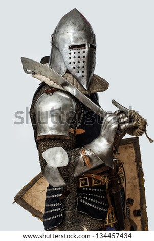 Image of knight who is posing with his right side - stock photo