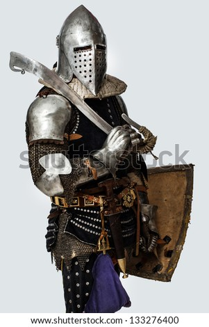 Image of knight with sword on his shoulder - stock photo