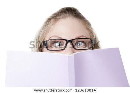 Image of lady covering her face with a book against white background - stock photo