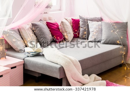 Image of large bed with colorful decorative cushions - stock photo