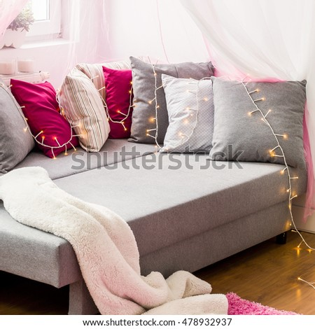 Image of large bed with colorful decorative cushions