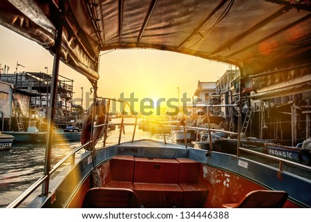 Image of little boat on river - stock photo