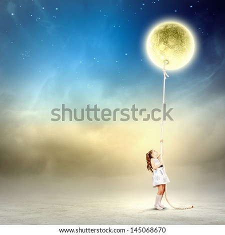 Image of little girl in white dress pulling moon - stock photo