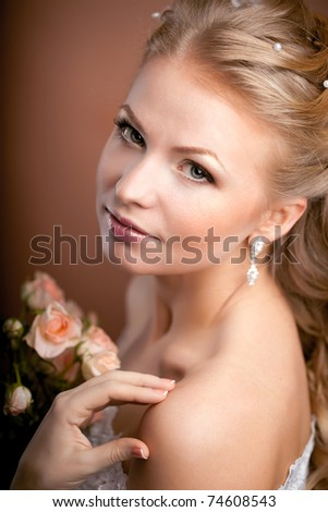 Image of luxury bride with wedding hairstyle - stock photo