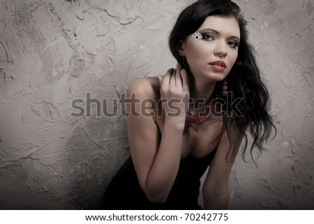 Image of luxury glamorous girl in the old room