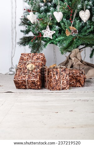 Image of luxury New Year gifts, different present boxes under Christmas tree, magic x-mas night, with place for sample text - stock photo